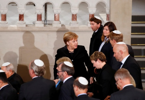 German Chancellor Angela Merkel is pictured after speaking at a ceremony to mark the 80th anniversary of Kristallnacht, also known as Night of Broken Glass, at Rykestrasse Synagogue, in Berlin