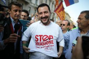 p14 Matteo Salvini, head of the Italian political party, Lega Nord, wears a T-shirt reading Stop Invasion during a demonstration with far-right activists against immigration in 2014 in Milan