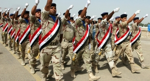 Iraqi Army soldiers march during a parade marking the founding anniversary of the army's artillery section in Baghdad